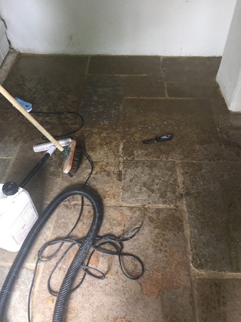 Sandstone tiled floo -before cleaning in Taunton Somerset